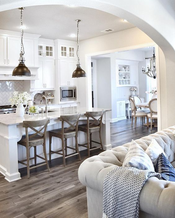 """Wall paint color is """"Sherwin Williams SW 7015 Repose Gray."""" - white kitchen with warmth added from wood"""
