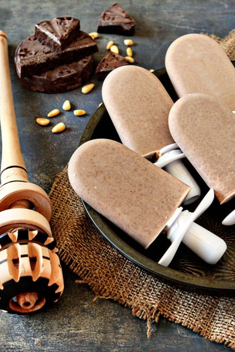 Spicy Mexican Chocolate Paletas ¼ cup pine nuts, roasted 1 Mexican Chocolate disc (recommended Ibarra or Abuelita Chocolate) 1 cup water 1 cup half & half 4 tablespoons condensed milk 1 teaspoon chile powder Simple syrup or agave nectar