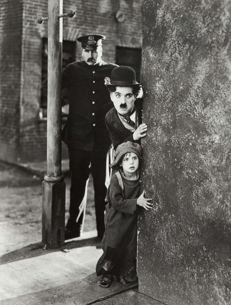 Charlie Chaplin, (The Kid)
