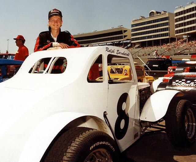 Dale Earnhardt Jr with one of his legend cars.