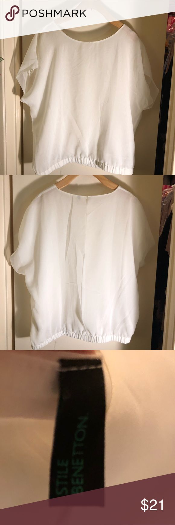 Delicate White Lined Sheer Shirt Perfect for summer. I have gently sewn the back since it was all open, but I can easily un-do it for you upon request. United Colors Of Benetton Tops Tees - Short Sleeve