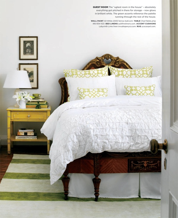 Guest room- old bed, white duvet cover, modern pillows