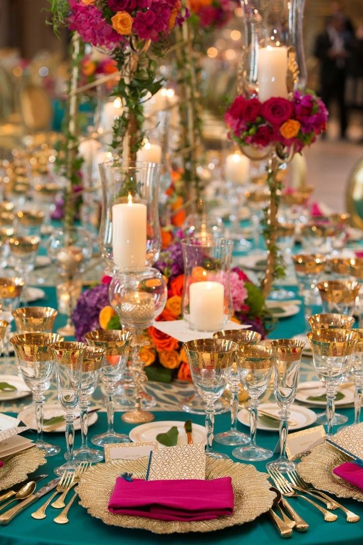 Best 25 moroccan wedding ideas on pinterest moroccan wedding turquoise linens gold flatware candles in glass vases pink napkin multi colored arrangements junglespirit Image collections