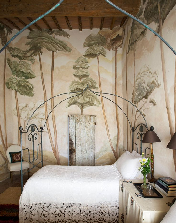 One of the bedrooms in interior designer Camilla Guinness's Arniano farmhouse, which is located near Montalcino.