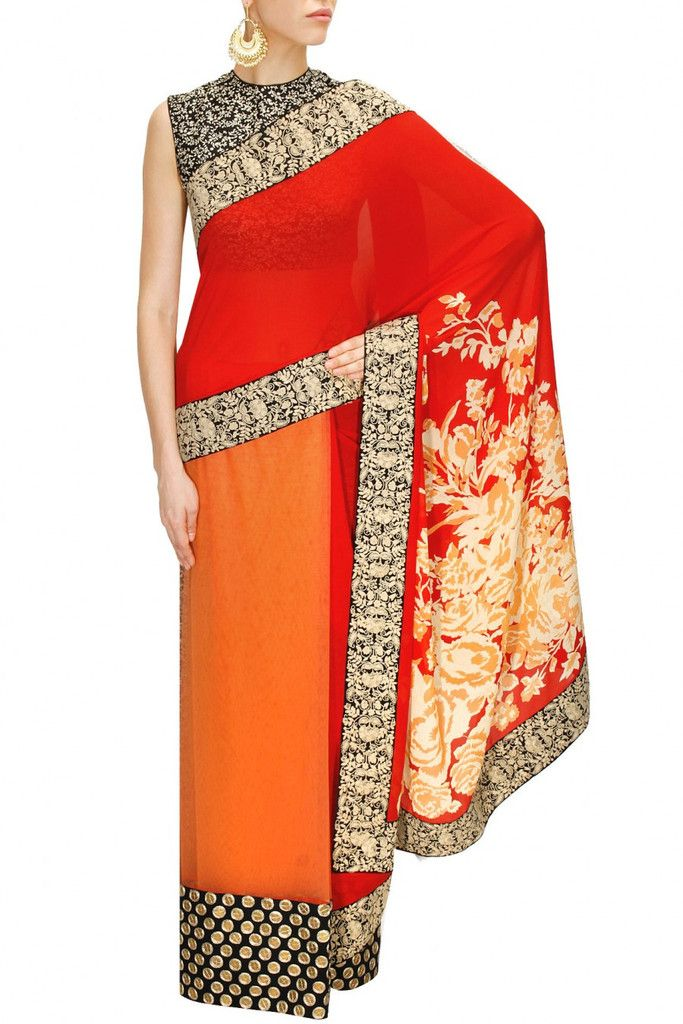 This peach and red saree is in tulle and georgette with floral printed pallu with sequins and thread work border. This peach and red saree is paired with black and white printed blouse and printed pet