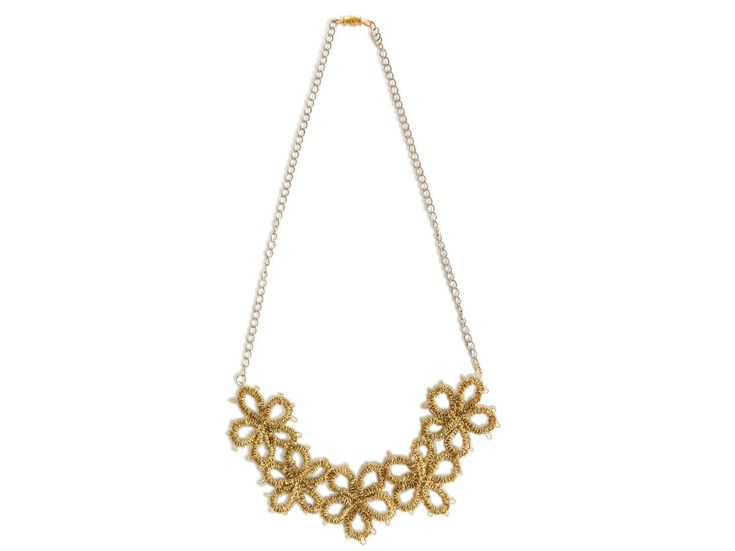 Unique handmade tatting necklace of gold thread caught chain.
