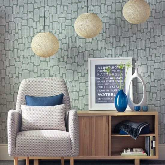 1950s living room  Add warmth to a cool scheme with an accent - inky blue (used here), burnt orange or mustard all work well. Choose furniture with textured weaves and small-scale patterns for a look that won't date.