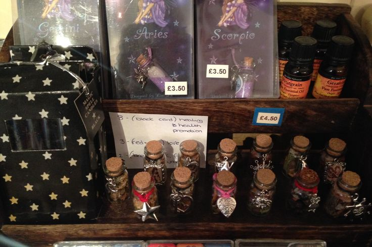 A small selection of my spell jars (bottom row) for sale in a local shop.