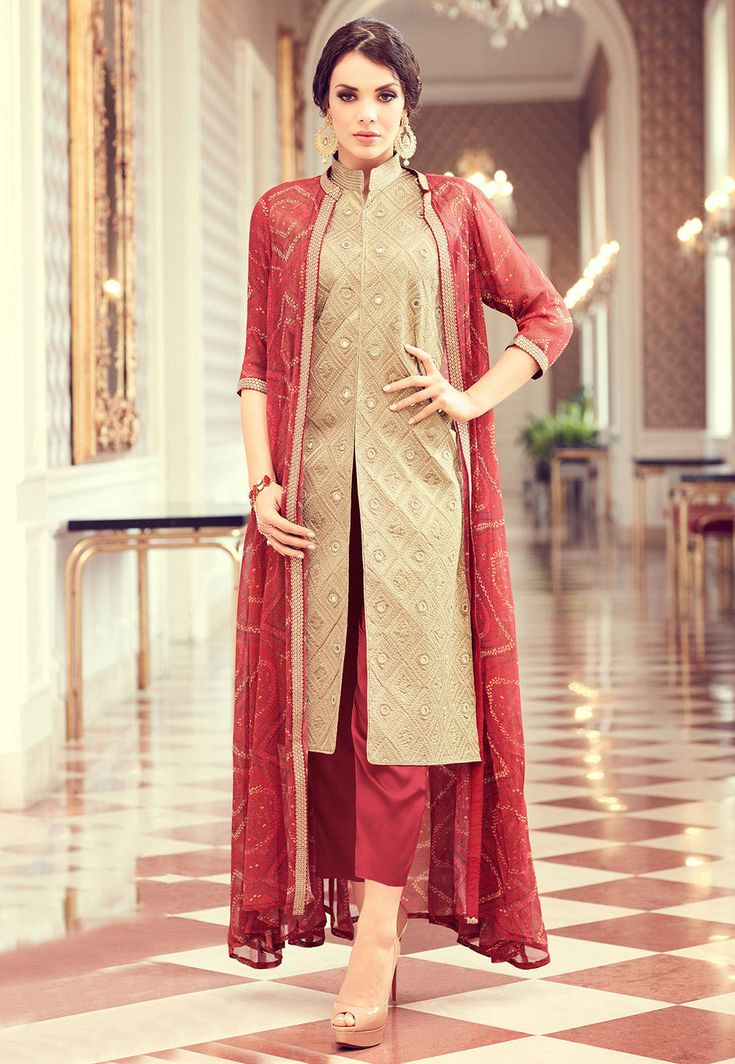 Art Silk Pakistani Suit in Beige This Semi-stitched Eyecatcher attire with Poly Shantoon Lining is Allured with Bandhej Print, Resham, Mirror and Patch Border Work and is Crafted in Chinese Collar Neck and Quarter Sleeve Available with a Poly Shantoon Pant in Red, Bandhej Printed Faux Crepe Long Jacket in Red and a Faux Chiffon Dupatta in Red The Lengths of the Kameez and Bottom are 48 and 42 inches respectively Do note: Accessories shown in the image are for presentation purposes only and…