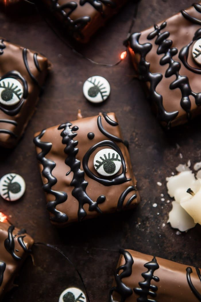 Hocus Pocus Spellbook Brownies: Cut up the brownies, dip through chocolate, add a jumbo candy eye, and decorate...simple as that! @halfbakedharvest.com