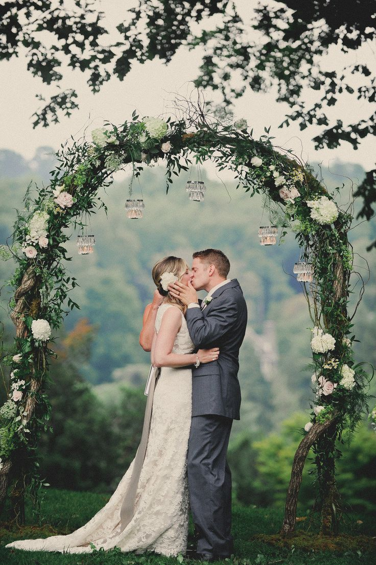 You would never know that this Philadelphia wedding was a rainy day affair. Mother Nature let up long enough for this couple to say their I-dos in total outdoor elegance. Thank goodness because Im 100% convinced the luscious, chandelier adorned arbor was meant. to. be. the backdrop for their super romantic first kiss.This adorable duo…