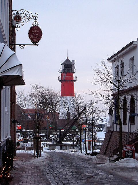 *The Harbor Street in Büsum, Germany, with a view of the lighthouse.
