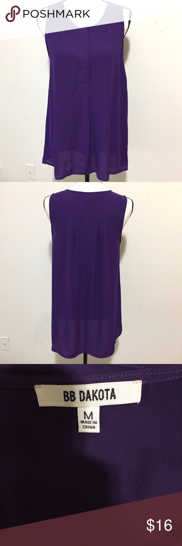 """NWT BB Dakota Long Tunic Sheer Tank Top This purple BB Dakota Long Tunic Sheer Tank Top blouse is brand new. The actual """"price tag"""" isn't attached, but you can see from the pictures that the extra button tag is still attached. Size Medium. Double layered so it's not see through. Lightweight and comfortable! BB Dakota Tops Tank Tops"""