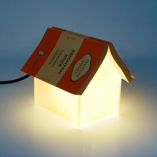 Book Rest Lamp Because who can keep track of a bookmark, really? Gone Reading, $69.99. (http://gonereading.com/product/book-rest-lamp/)
