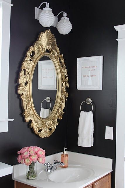 Dark walls and gold mirror. Bathroomstyle