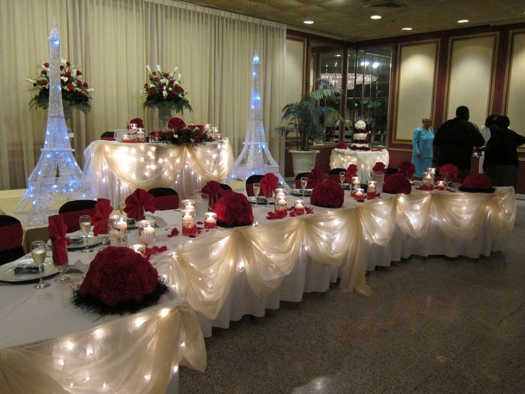 red and black head table decor