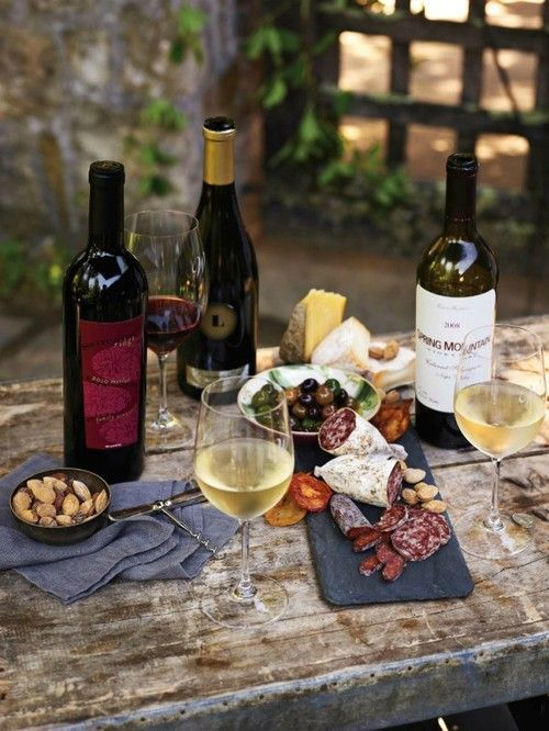 wine, cheese, olives and nuts