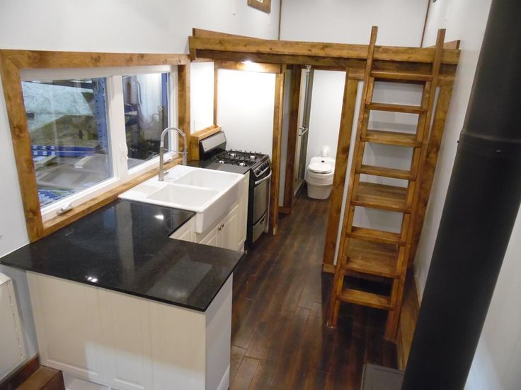 Kitchen with Peninsula - 27' Off Grid by Upper Valley Tiny Homes