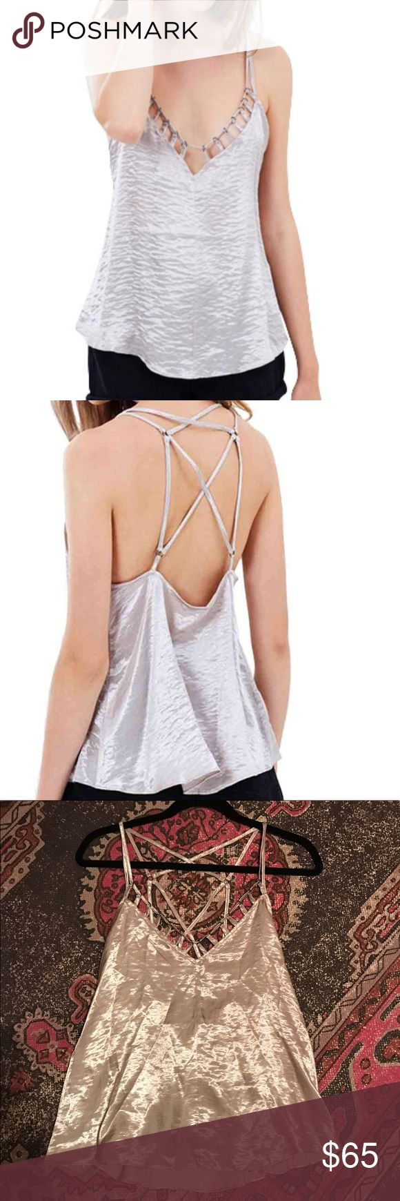 NWT Free People Silver Haze Cami Top NWT size Small • Gorgeous silver cami-style top • embellished detail • cut out detail • Strappy back • Pullover styling • This top is stunning!!  No flaws Free People Tops Tank Tops