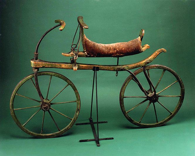 """Image description: In 1817, Karl Drais, a young inventor in Baden, Germany, designed and built a two-wheeled, wooden vehicle that was straddled and propelled by walking swiftly. Drais called it the laufmaschine or """"running machine.""""  By 1818, the draisine craze reached the United States, but the high cost of the vehicle, combined with its lack of practical value, made it little more than an expensive toy. The two-wheeled vehicle would not become sustained until pedals were added in the l"""