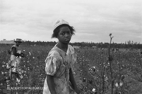 King Cotton | 1935, via Flickr. A weary young girl picking cotton, mother in the background (Arkansas), 1935.    Vintage African American photography courtesy of Black History Album, The Way We Were.    Follow Them On Twitter @blackhistoryalb