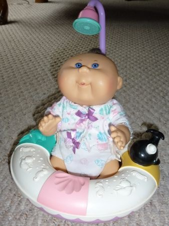 Cabbage patch doll with shower and floaty. I definitely had one of these growing up!