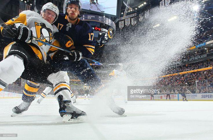 Jordan Nolan #17 of the Buffalo Sabres battles with Matt Hunwick #22 of the Pittsburgh Penguins during an NHL game on December 1, 2017 at KeyBank Center in Buffalo, New York.
