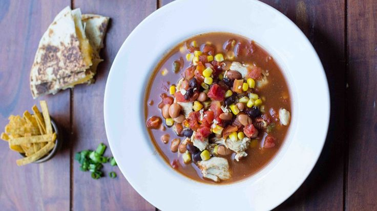 Just five cans + shredded chicken and taco seasoning and you've got a tasty Tex-Mex slow-cooker dinner without any extra dishes!
