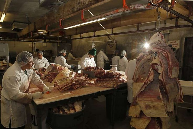 Butchers process meat at Marin Sun Farms' present location in the Dogpatch neighborhood. The gourmet grass-fed meat company is moving its operations into a larger facility on Bryant Street. Photo: Michael Macor, San Francisco Chronicle