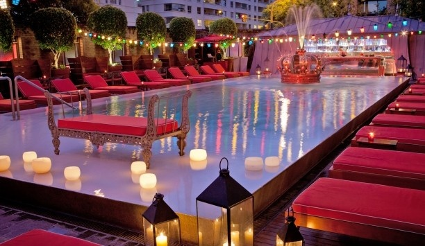 Love  the crown water feature. Faena Hotel and Universe: pool area.