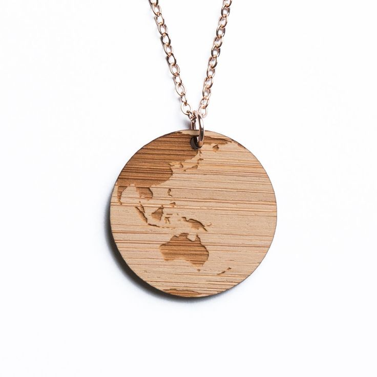 Australia and Oceania map necklace, etched into eco-friendly FSC certified bamboo (using a laser burner), on a recycled rose gold plated sterling silver chain.