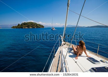 Young woman Sailing On Yacht in Greece