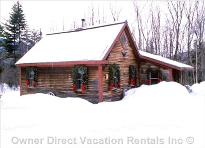 Rustic luxury at this cozy cabin for rent in Stowe, Vermont nestled on 4 wooded acres and just one mile from Stowe village.
