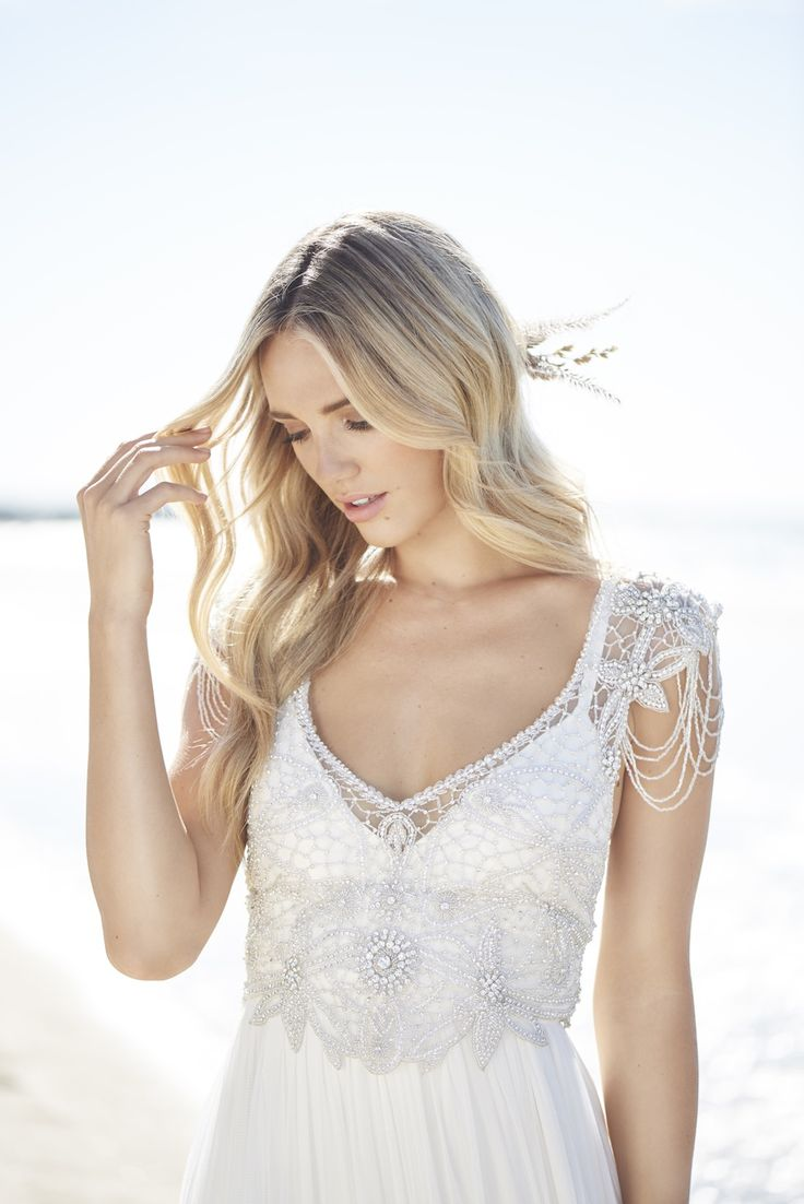 Anna Campbell Signature Collection | Vintage-inspired bohemian boho barefoot bride wedding dresses | Hand embellished bridal gowns with sparkling hand beading | Low back detail with lace | Vintage glamour | Romantic wedding dress | Feature back detail with bow | #vintagebride #vintagewedding #glamourousweddingdress #beadedweddingdress #embellishedbridaldress #beachwedding
