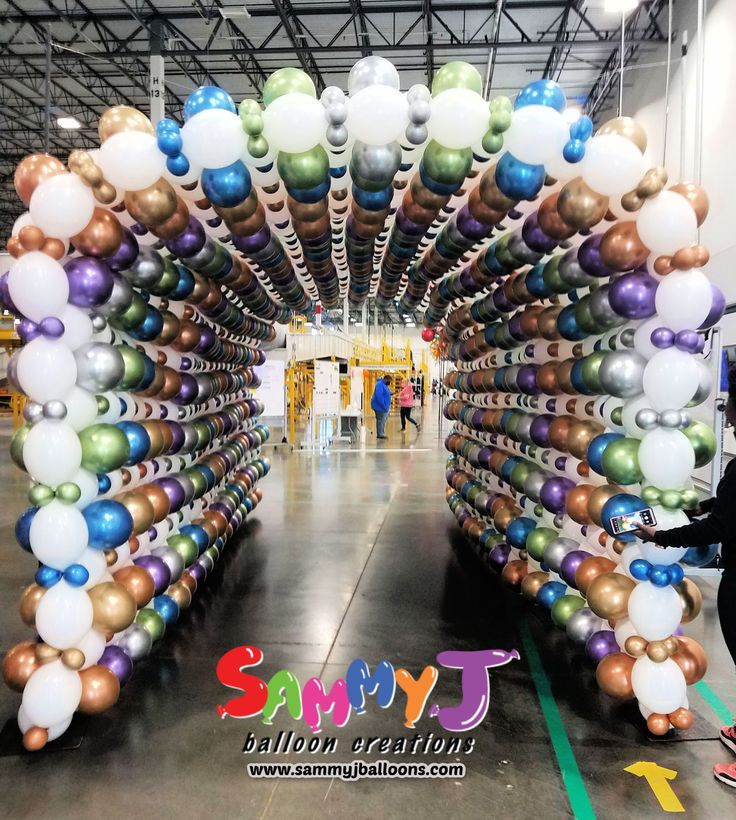 A 20ft long, 8ft tall balloon tunnel welcomed employees to work. They loved the unique entrance and taking selfies in front of all the beautiful colors. Made with Chrome and Reflex metallic balloons. #partyballoon #balloonparty #balloonart #sammyj #sammyjballoons #sammyjballooncreations #balloons #balloon #stlballoon #stlballoons #stlouisballoons #photooftheday #picoftheday #balloonartist #balloonsculpture #Betallic #Qualatex