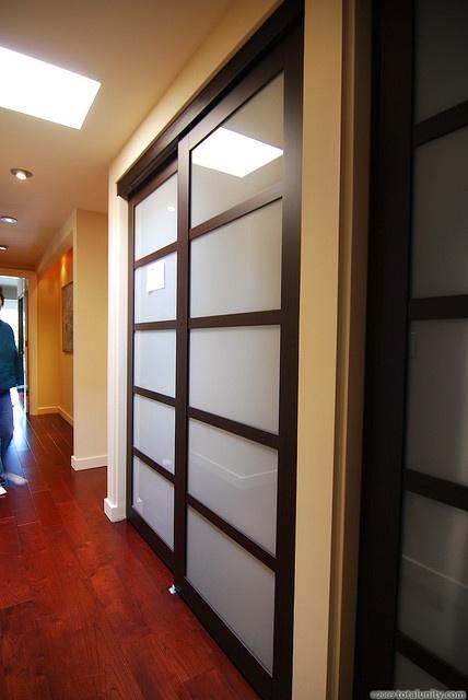 updated shoji-style sliding closet doors with translucent glass