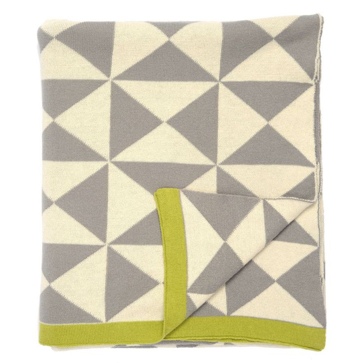 A chic 100% cotton woven throw blanket in gray, white and grass green from Crane and Canopy.