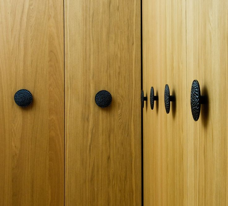 these large pomegranate pulls make a fantastic statement on these ikea doors