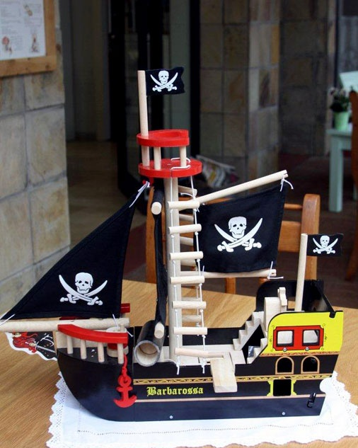 Pirate ship skull and crossbones fabric sails, firing canon (that really shoots canon-balls), and crows-nest. Size 490mm wide x 190mm deep x 480mm high.