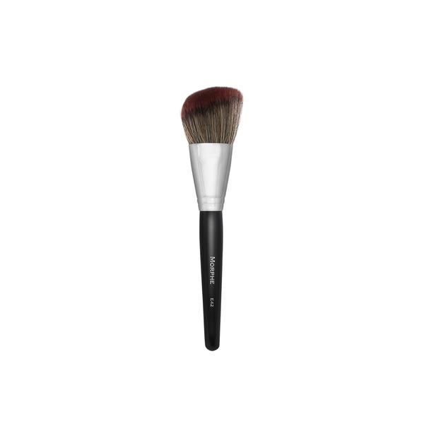 """Luxurious, deluxe-sized brush for a soft, natural contour. The angled head will leave a diffused wash of color in targeted areas of the face. Synthetic Bristles Full Length: 8"""""""