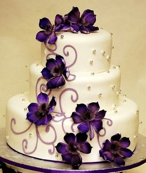 White 3 Tier Wedding Cake With Purple Flowers And Silver Accent