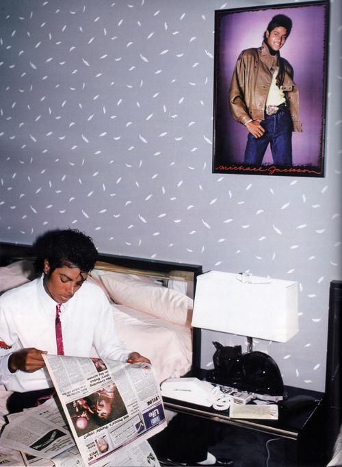 unknown artist, Michael Jackson reading a Prince article in a room with a poster of Michael Jackson on the wall,  ca. 1980s