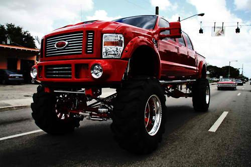 Ford 6 Door Truck. Not a fan of extended extended cabs, but this lifted red Powerstroke pulls it off.