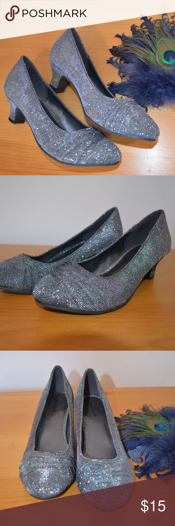 American Eagle by Payless Silver Shoes Sz 5 Beautiful silver, sparkle shoes with tie front detail.  Size 5 with 2 inch heel. Like new condition!  *The brand is American Eagle by Payless, not American Eagle Outfitters. American Eagle By Payless Shoes Heels