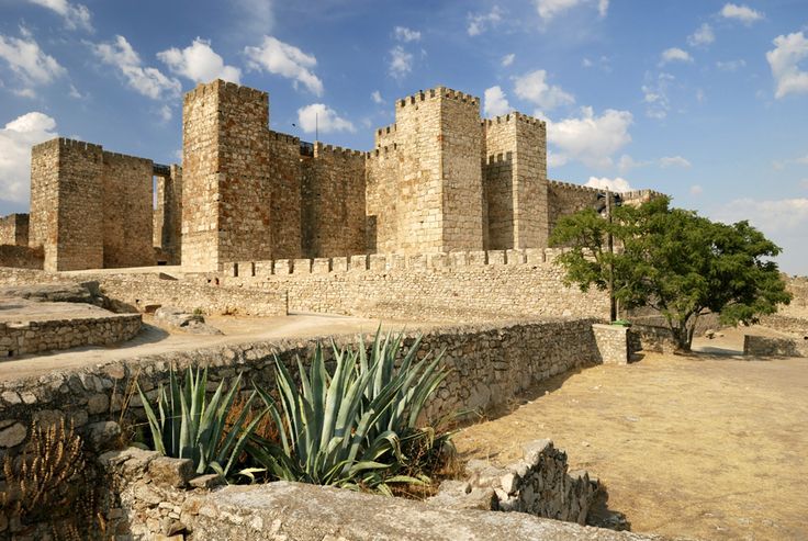 CASTLES OF SPAIN - Trujillo Castle, Cáceres, was built between the 9th and 12th centuries. It was raised over the remains of an old Moslem citadel,  The square towers typical of Islamic military architecture are preserved, is built of blocks of dressed granite with seventeen square defence towers around it, two of which protect the entrance gate which has a horseshoe arch. The city of Trujillo was taken during the Moorish invasion of 711 and remained in Muslim hands until 1232.