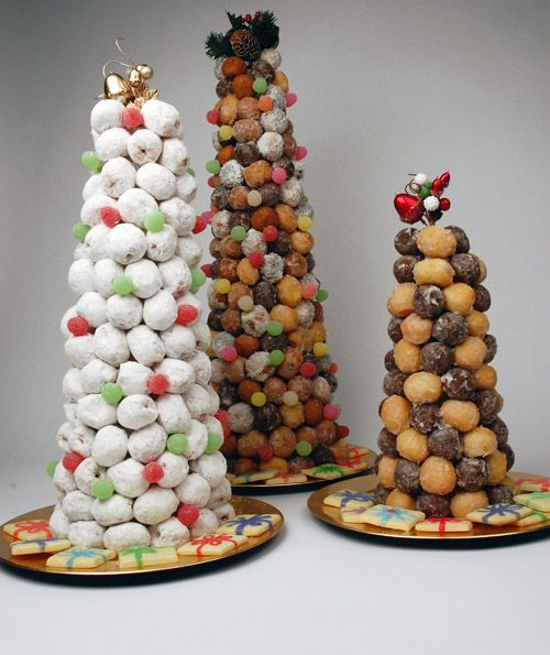 Wrap styrofoam tree in double plastic wrap. Put toothpick in halfway and then put on donut - start at bottom