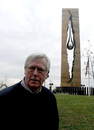 Look for The Teardrop. John Craven poses next to the 100ft-tall tribute to the victims of 9/11.