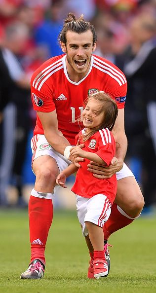 #EURO2016 Paris France 25 June 2016 Gareth Bale of Wales and his daughter Alba following their victory in the UEFA Euro 2016 Round of 16 match between Wales...