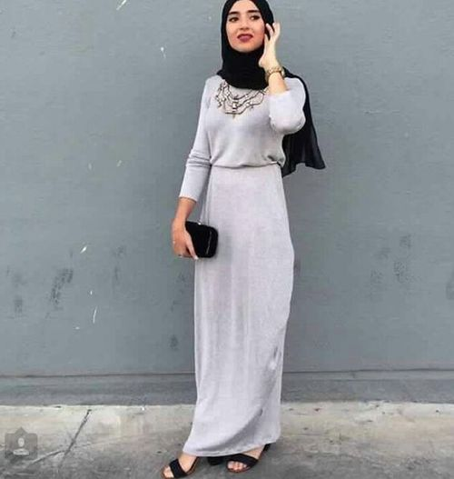 Hijab Outfit- Meets Modesty because it covers most of the body according to her religeon