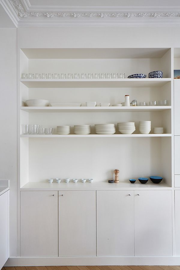 Custom recessed shelving in this Paris kitchen by A+B Kasha provides the perfect display setting for simple dishware and treasured objects. Photo by Idha Lindhag.